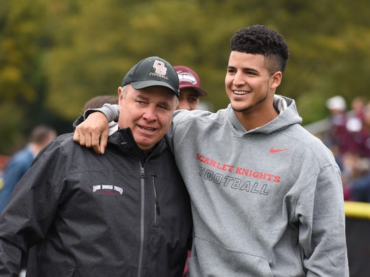 """Don Bosco coach Greg Toal with Rutgers starting quarterback Gary Nova before Don Bosco's game against Paramus Catholic at Paramus on Oct. 11, 2014. """"All I can say is there are two people who have had the most impact on my life, one is my father and the next is Coach Toal,"""" Nova said."""