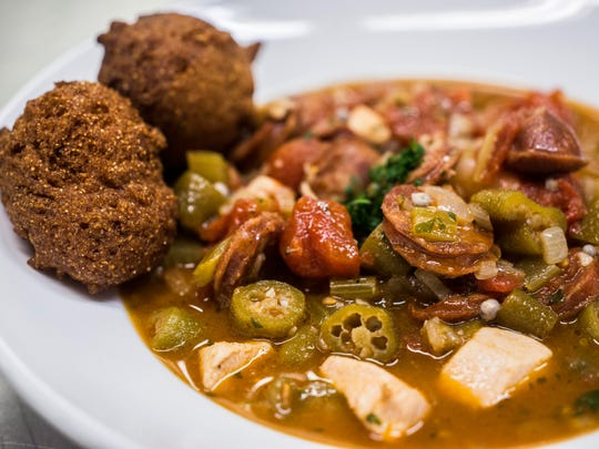 """A bowl of """"gumbo-laya"""", a combination of gumbo and jambalaya recipes, served with hush puppies awaits students for tasting at Burlington Tech Center's Champlain Cafe kitchen at Burlington High School on Tuesday, Feb. 23, 2017. As a rule, students sample everything they cook."""