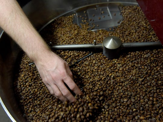 Andrew Fritz roasts coffee at Coffea Roasterie on Wednesday