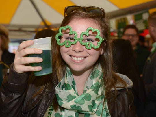 Molly Malone's in Covington celebrated St. Patrick's early with Kegs and Eggs and live music.  On St. Patrick's Day everyone is Irish!  Kylee Meeker of Dent with green beer and green glasses.