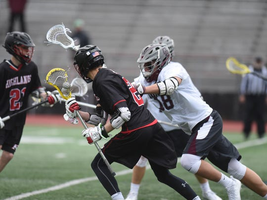 # 2 Cooper Richards drives the ball boys lacrosse game