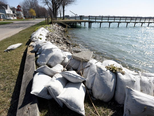 Sand bags protect the beach from erosion Friday, April 14, along South Channel Drive on Harsens Island.