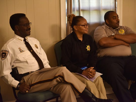 Hinds County Sheriff Victor Mason, from left, and staff