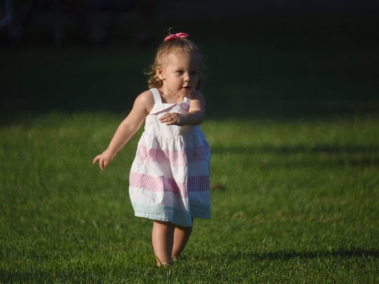 One and a half year old Jaqueline Carella dancing as the Rachel Allyn Band is performing at Morgan's Farms in Cedar Grove.