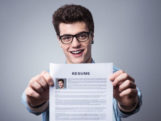 Young man with resume