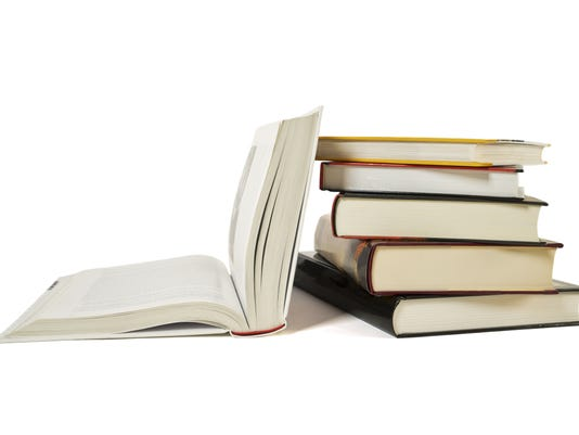 High books stack, open book isolated white background. Colorful covers.