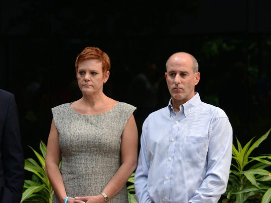 Dianne and Seth Grossman at a press conference at which