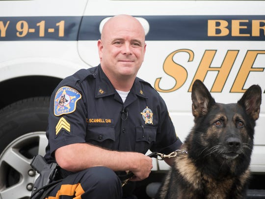 Sgt. Timothy Scannell, Bergen County Sheriff's Officer in charge of the county's K-9 unit, with his dog, Odin.
