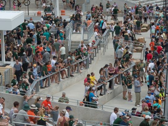 Fans find a spot on the New Belgium Porch during an open house for CSU's new on-campus football stadium on Saturday, August 5, 2017. More than 10,000 Rams fans got their first look at the facility with a concessions and amenities in operation.
