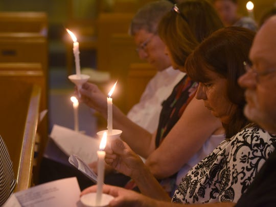 Friends attend a vigil at The Church of the Annunciation,