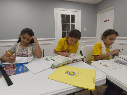 Basmala Radwan (11), Jenna AbuAbeid (9) and Salam AbuAbeid