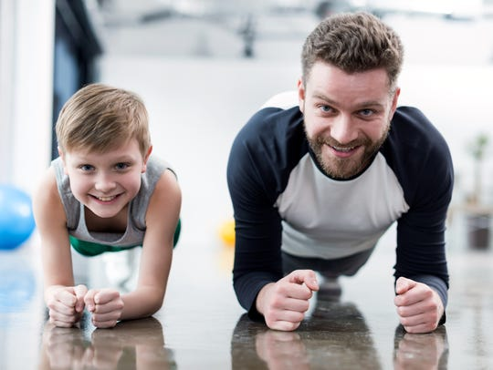 Plank workouts provide a body-weight workout that can help build core strength as well as toning while watching television or hanging out with your kid.
