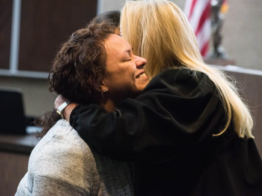 Judge Deeanne Galvan hugs Red Cord graduate Jessica Rodriguez on Thursday, October 19, 2017 at the Nueces County Courthouse in Corpus Christi.