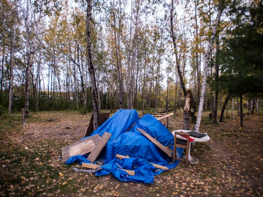 A few things from Nick Walls and partner Ashley Baker's camp off Sears Lane in Burlington's South End remain, but most of the homeless camp there was taken away after the city carried out an eviction there on Thursday, Oct. 19, 2017.