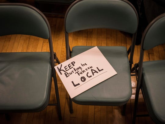 A sign in support of Keep Burlington Telecom Local is momentarily left on a seat during a late-night recess of the Burlington City Council meeting Monday night, Oct. 30, 2017, after several councilors, Kurt Wright, David Hartnett, Sharon Bushor and Ali Dieng all expressed concerns about citing for the final Burlington Telecom bidder in light of Councilor Karen Paul's abrupt recusal, citing a conflict of interest she recently discovered.
