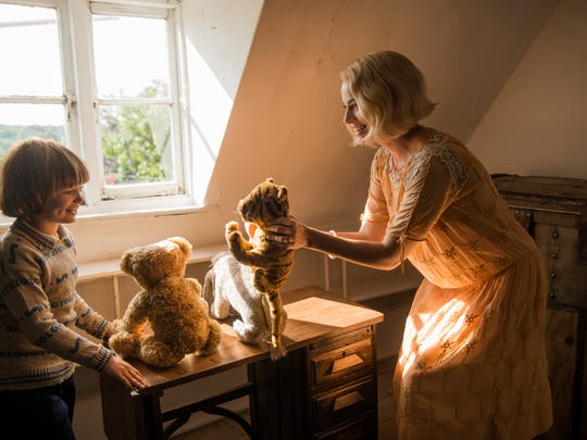 "Will Tilston and Margot Robbie play with Pooh and friends in ""Goodbye Christopher Robin."""