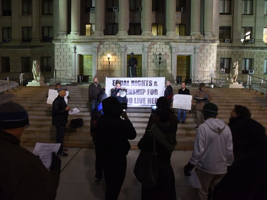 Participants in a rally in Newark demand a stop to immigrant detention in Essex County
