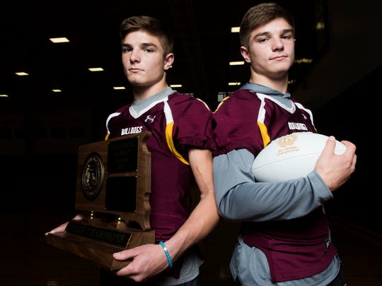 Twin brothers Jaxon (left) and Jadon (right) Janke pose for a portrait at Madison High School on Nov. 14, 2017. The brothers have led their team to three straight Class A Football State Championships.
