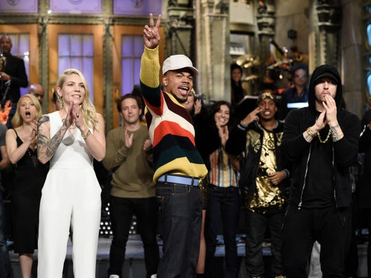 """Eminem, right, with Skylar Grey and Chance the Rapper during the sendoff segment of """"Saturday Night Live"""" on Nov. 18, 2017."""