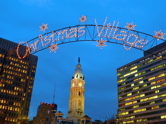 Philadelphia's Christmas Village is returned to Love Park, which is still under construction, following last year's temporary move to City Hall.