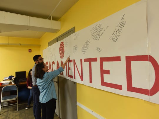 Dreamers signs a banner that will be delivered to Representative