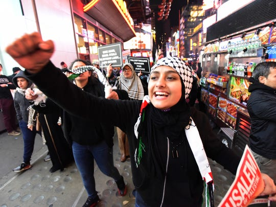 Palestinian supporters protest in Times Square.