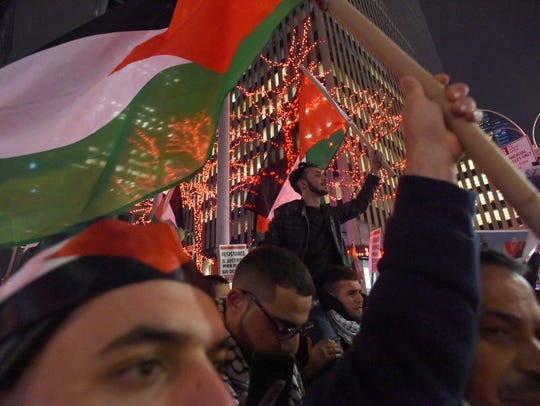 Protesters waved Palestinian flags at a protest on