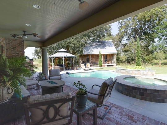 There is a guest cottage near the pool and plenty of entertainment space.