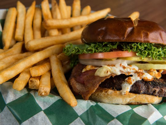 "Crunchy's ""Black & Bleu"" burger is Cajun-seasoned beef,"