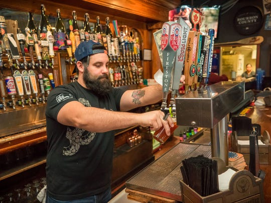 Don Ericson, 40, of Des Moines, serving up drinks to