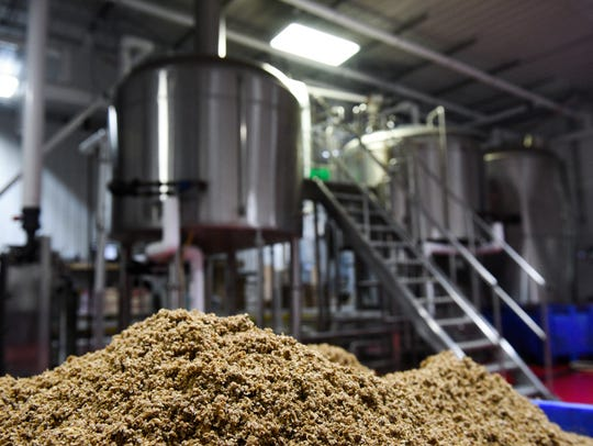 Spent grain created in the brewing process sits at