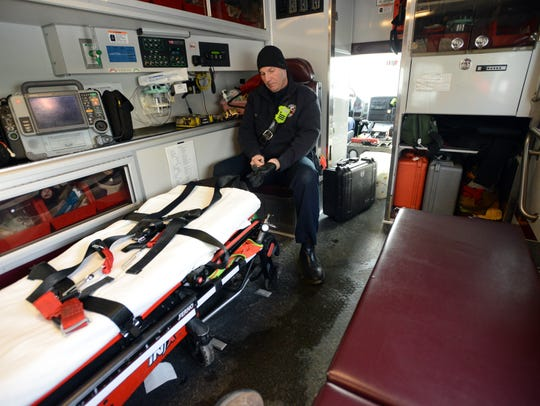 Lancaster firefighter Kevin Nagle puts gloves on as
