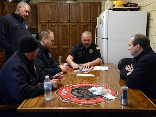 Lancaster Assistant Fire Chief Jack Mattlin goes over
