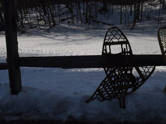 Snowshoes sit out in Hackett Hill Park on Sunday. Winterfest featured snowshoeing, cross-country skiing and nature walks.