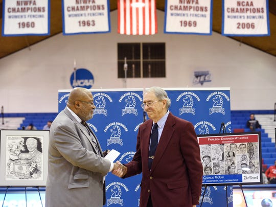 (right) Charlie McGill is honored by the Fairleigh Dickinson University Athletic Department during halftime of a men's basketball game on Thursday, January 25, 2018. (left) Director of Athletics David Langford.