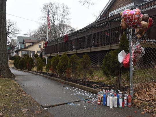 A mural with balloons and candles sits in front of the Exempt Firemen's Association on North Clinton Street on Sunday afternoon. City police identified city resident Noel McClinton, 35, as the victim in Saturday's fatal shooting.