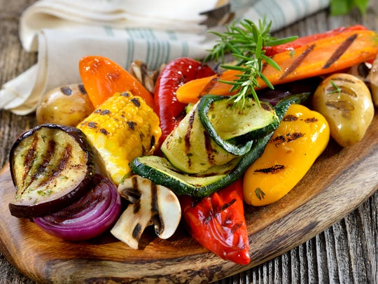 Grilled mixed vegetables on a wooden cutting board