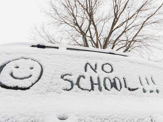 NO SCHOOL!!!  with a smiley face written in snow on car side window