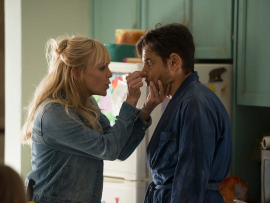 "Anna Faris (left) and Eugenio Derbez star in ""Overboard,"""