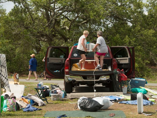 Campers at Fort Pickens pack their gear Saturday, May