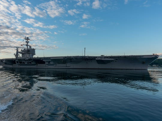 USS John C. Stennis transits the Puget Sound as it departs Bremerton in June for training ahead of its next scheduled deployment.