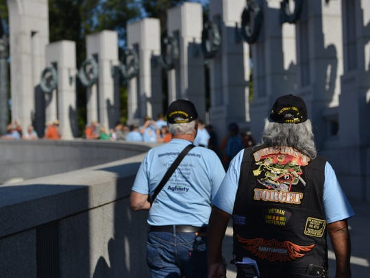 Veterans traveling with Honor Flight Northern Colorado walk at the World War II Memorial in Washington, D.C., in September 2015.