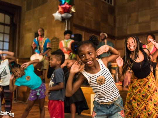 The Kuumba Watoto Children's Drum and Dance Company, led by Takia Finiyi, invite all to come up and join in the joy.