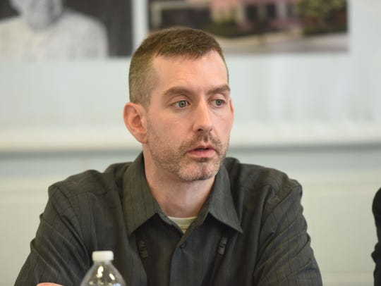 """Josh Copeland, certified peer recovery specialist, speaks during a panel discussion on """"Bridging the Gap between Addiction and Recovery."""""""