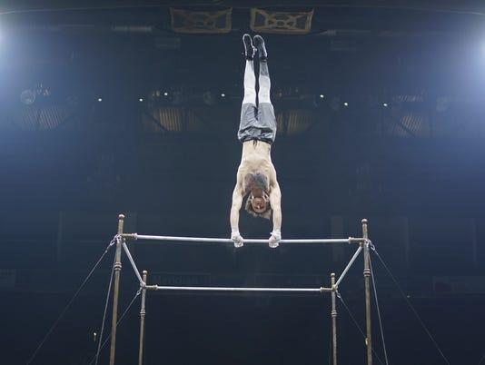 636682886734650656-Cirque-de-Soleil-workout-high-bar-front-BEST.jpeg