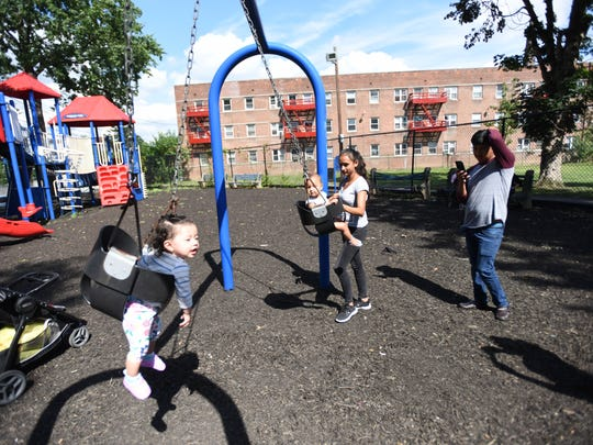 Families using the playground equipment during a community