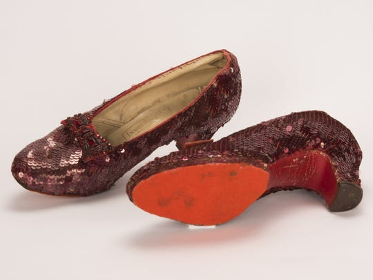 "A pair of ruby slippers, known as the ""traveling pair,"""