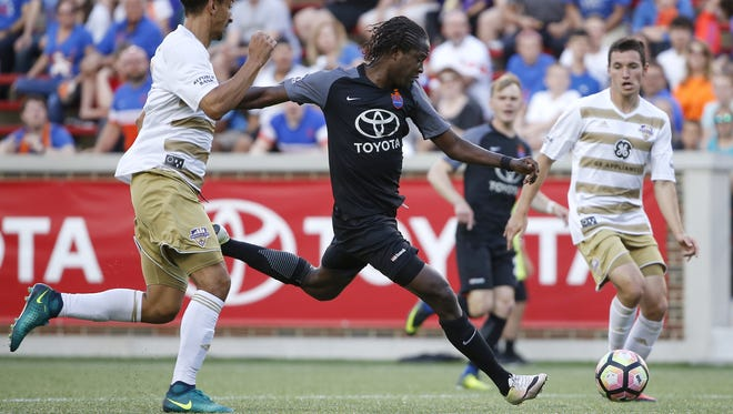 FC Cincinnati forward Djiby Fall (9), center, takes a shot on goal in the first half during the Lamar Hunt US Open Cup game between Louisville City FC and FC Cincinnati Wednesday at Nippert Stadium.