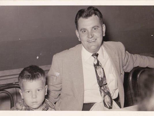 Author pictured with father in 1955
