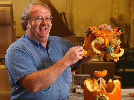 Dwaine Crigger shows off his pumpkin art in a 2003